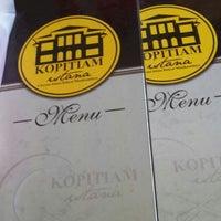 Photo taken at Kopitiam Istana by Nurul S. on 6/20/2014