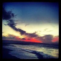 Photo taken at Ehukai Beach by Daniela A. on 12/11/2012