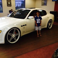 Photo taken at Formula 1 Auto Imports by Fina E. on 7/16/2014