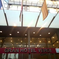 Photo taken at Catalonia Gran Hotel Verdi by Sevgi Y. on 6/20/2014