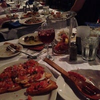 Photo taken at Tango Argentinean Grill by Jill C. on 5/9/2014