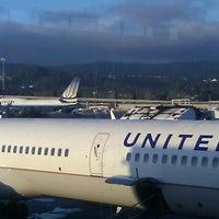 Photo taken at Gate 85 by Tim M. on 12/6/2012