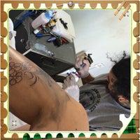 Photo taken at Novo Estudio Bala Tattoo e Piercing by Carol F. on 9/18/2014