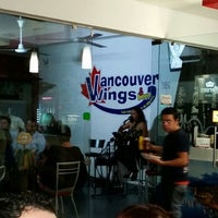 Photo taken at Vancouver Wings & beer by Moises R. on 1/16/2015
