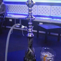 Photo taken at Illusions Hookah and Mixology Lounge by Radilsa D. on 2/9/2016