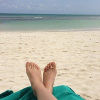 Photo taken at Beach at Secrets Silversands by Liv H. on 3/13/2013