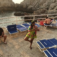 Photo taken at Faro di Punta Carena by Fatou B. on 8/9/2015