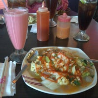 Photo taken at Solaria by Azrawinda A. on 1/31/2014