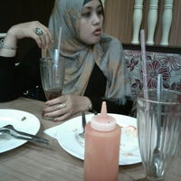 Photo taken at Solaria by Farisah R. on 6/11/2014