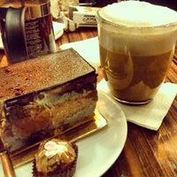 Photo taken at Le Petit Café by Tarlan G. on 12/17/2013