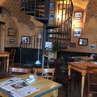 Photo taken at Le Petit Café by Mariah D. on 2/27/2014