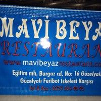 Photo taken at Mavi Beyaz Restaurant Cafe Bar by Ferit A. on 1/24/2014