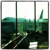 Photo taken at Gate D46 by BJ Y. S. on 10/25/2012