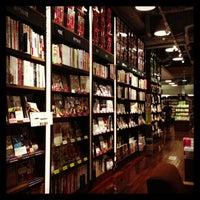 Photo taken at Tsutaya Book Store Tenjin by Chikako M. on 6/1/2013