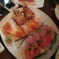 Photo taken at Rise Modern Asian Cuisine and Sushi by Denis F. on 1/7/2014