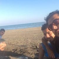 Photo taken at Işık Beach by Murat Atıcı on 7/25/2015