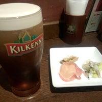 Photo taken at Irish Pub Stasiun (スタシェーン) 上野駅店 by Yoshichika W. on 4/2/2014