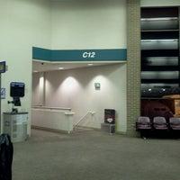 Photo taken at Concourse C by Cynthia W. on 2/27/2013