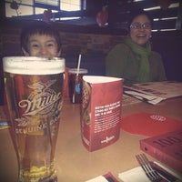 Photo taken at Boston Pizza by Adam S. on 1/25/2014