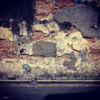 Photo taken at Penang Street Art : Little Boy with Pet Dinosaur by J'J' J. on 2/20/2013