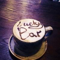 Photo taken at Lucky Bar by Olga K. on 12/14/2013