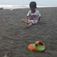 Photo taken at Pantai Kuwaru by Nining R. on 4/20/2014