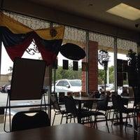 Photo taken at La Pergola Cafe by Ariel M. on 12/28/2013