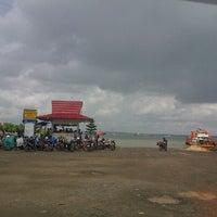 Photo taken at Pelabuhan Ferry Tarjun by jams c. on 1/4/2014