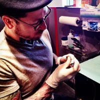 Photo taken at Shaman Modifications Tattoo and Body Piercing by Umyot B. on 12/2/2012
