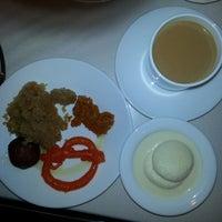 Photo taken at Shalimar Indian Restaurant by Jamie W. on 1/4/2014