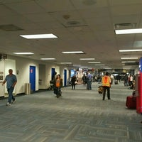 Photo taken at Concourse C by Alice K. on 12/18/2016