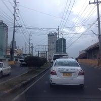 Photo taken at J.P. Rizal Bridge by Enrico M. on 12/21/2013