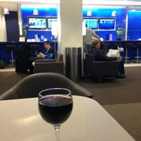 Photo taken at Delta Sky Club by Concetta L. on 2/13/2013