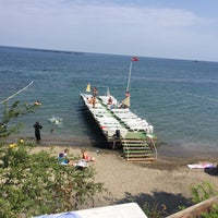 Photo taken at Aile Beach by Deniz Ö. on 8/10/2017