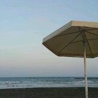 Photo taken at Işık Beach by Işık Su G. on 8/17/2016