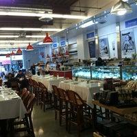 Photo taken at Monsieur Marcel Gourmet Market by Barbara D. on 1/25/2013