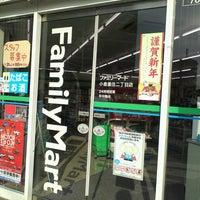Photo taken at ファミリーマート 小倉重住店 by Thomas S. on 1/4/2014