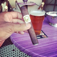 Photo taken at Churchill's Cigar Lounge by Michael M. on 10/5/2014