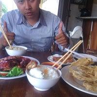 Photo taken at Wajan Oriental Cuisine by Erik Ramdani E. on 1/2/2014