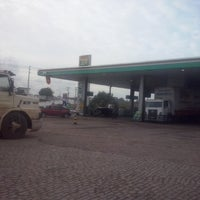 Photo taken at Posto Magnólia 2000 by Ronaldo #. on 1/9/2014