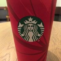 Photo taken at Starbucks by Wataru I. on 11/12/2014