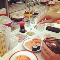 Photo taken at YO! Sushi by Charlotte N. on 8/2/2013