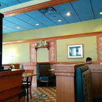 Photo taken at Swiss Chalet by Tatiana on 5/15/2014