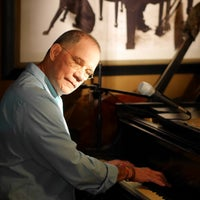 Photo taken at Carli's Fine Bistro and Piano by Justin V. on 3/2/2014