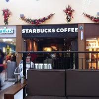 Photo taken at Starbucks by Luis G. on 12/23/2012