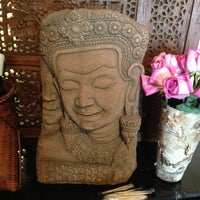 Photo taken at Buddha Ruksa by Cheryl C. on 5/22/2013