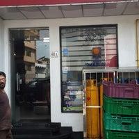 Photo taken at dine more by Thavarajah C. on 3/9/2014