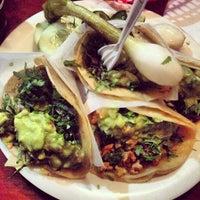Photo taken at Tacos El Bronco Restaurant by Craig B. on 2/22/2014