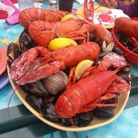 Photo taken at Gilligan's Clam Bar and Grill by Justin R. on 5/9/2013