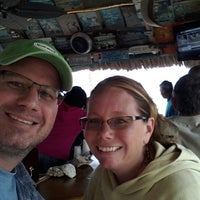 Photo taken at Tiki Bar at Riptide Hotel by Marty E. on 2/28/2013